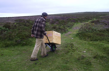 Peter Bodenham pushing the Eli cart over rough ground